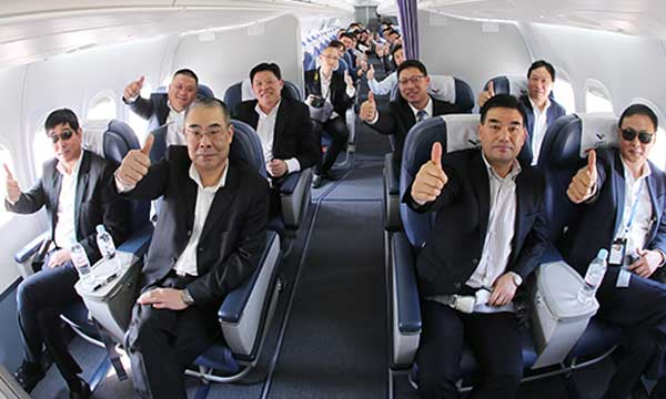 First customer representatives ride on ARJ21-700 aircraf